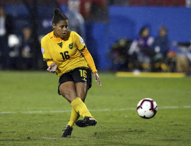 FILE - In this Oct. 17, 2018, file photo, Jamaica defender Dominique Bond-flasza (16) takes the winning penalty kick to defeat Panama in the third place match of the CONCACAF women's World Cup qualifying tournament in Frisco, Texas. Just a handful of years ago, Jamaica didn't even have a women's national team. The Reggae Girlz, as they're known, are also the first Caribbean team to qualify for the Women's World Cup, which opens June 7 in France. (AP Photo/Richard W. Rodriguez, File)