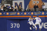 New York Mets' Michael Conforto (30) and Brandon Nimmo celebrate after Atlanta Braves during their baseball game, Wednesday, July 28, 2021, in New York. The Mets won 2-1. (AP Photo/Mary Altaffer)