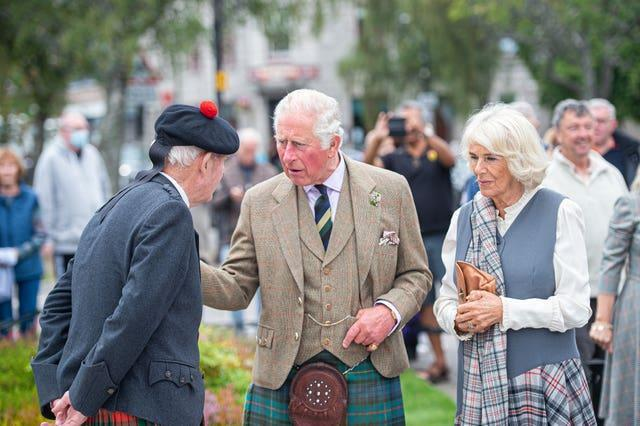 Charles and Camilla on a walk through the village during a visit to the Ballater Community & Heritage Hub in Ballater, Aberdeenshire (Wullie Marr/DCT Media/PA)