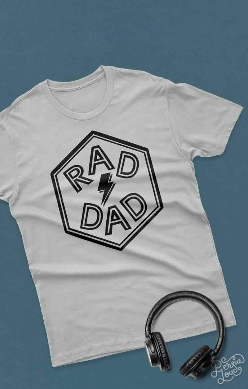 """<p>Flatter your father with a complimentary T-shirt that's done in just two steps: cut out the decal, then iron it on. Alternatively, you can adhere this decal (scaled, of course) to something else—a coffee mug or tote bag, for example. </p><p><a href=""""https://persialou.com/rad-dad-free-svg-cut-file-for-fathers-day/"""" rel=""""nofollow noopener"""" target=""""_blank"""" data-ylk=""""slk:Get the cut file."""" class=""""link rapid-noclick-resp"""">Get the cut file. </a></p><p><a class=""""link rapid-noclick-resp"""" href=""""https://www.amazon.com/Hanes-3-Pack-Tagless-T-Shirt-White/dp/B000C4UATA?tag=syn-yahoo-20&ascsubtag=%5Bartid%7C10072.g.27603456%5Bsrc%7Cyahoo-us"""" rel=""""nofollow noopener"""" target=""""_blank"""" data-ylk=""""slk:SHOP T-SHIRT"""">SHOP T-SHIRT</a></p>"""