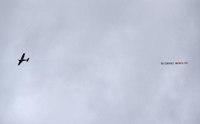 <span>A plane is seen flying over the stadium dispalying a message about Arsene Wenger</span> <span>Credit: Getty iMages </span>