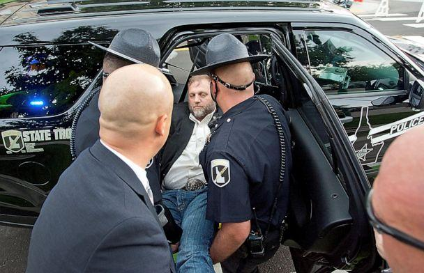 PHOTO: Idaho State troopers place Ammon Bundy in a waiting patrol car after he was arrested for trespassing at a special legislative session at the Idaho State Capital in Boise, Idaho, Aug. 25, 2020. (Brian Myrick/Idaho Press via Reuters)