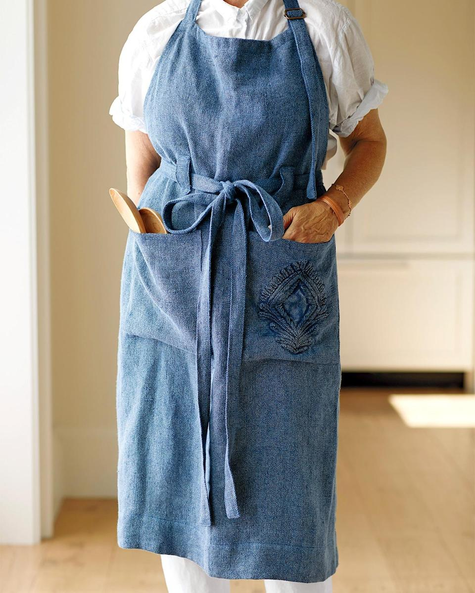 """<p>Shopping for an apron with a little more pizzazz? This lightweight linen iteration features an adjustable brass buckle and two large pockets, including one with an <a href=""""https://www.marthastewart.com/921435/embroidery-how"""" rel=""""nofollow noopener"""" target=""""_blank"""" data-ylk=""""slk:embroidered medallion design"""" class=""""link rapid-noclick-resp"""">embroidered medallion design</a>, for a little extra oomph.</p> <p><strong><em>Shop Now: </em></strong><em>Serena & Lily Leighton Apron, $98, <a href=""""https://www.pjtra.com/t/8-4759-131940-50885?sid=MSL12StylishApronsThatHaveYouCoveredintheKitchensmeyerKitGal7844953202007I&url=https%3A%2F%2Fwww.serenaandlily.com%2Fleighton-apron%2Fm12920.html"""" rel=""""nofollow noopener"""" target=""""_blank"""" data-ylk=""""slk:serenaandlily.com"""" class=""""link rapid-noclick-resp"""">serenaandlily.com</a></em><em>. </em></p>"""