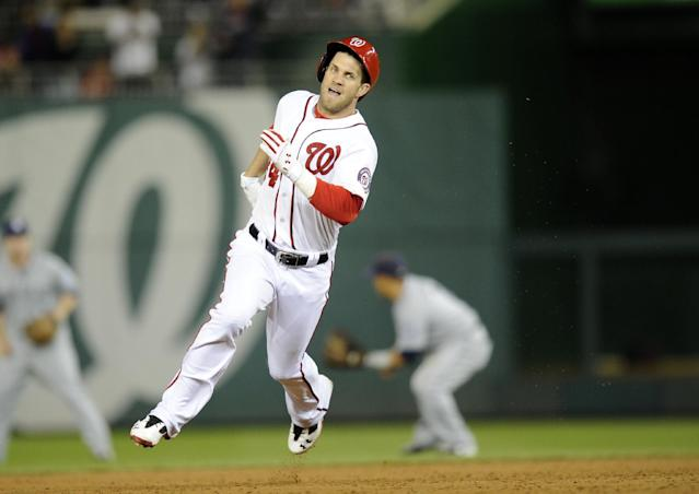Washington Nationals left fielder Bryce Harper runs towards third with a three RBI triple during the third inning of a baseball game against the San Diego Padres, Friday, April 25, 2014, in Washington. (AP Photo/Nick Wass)
