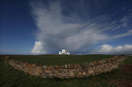 A dry stone wall surrounds a field outside Torness nuclear power station in Dunbar, Scotland May 13, 2013. REUTERS/Suzanne Plunkett