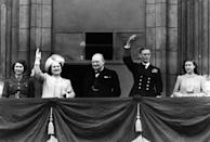 """<p>King George VI and <a href=""""https://www.townandcountrymag.com/leisure/arts-and-culture/news/g2939/cast-the-crown-real-life/"""" rel=""""nofollow noopener"""" target=""""_blank"""" data-ylk=""""slk:Winston Churchill"""" class=""""link rapid-noclick-resp"""">Winston Churchill</a>, who became close friends during WWII, appear together on balcony during Victory Day celebrations</p>"""