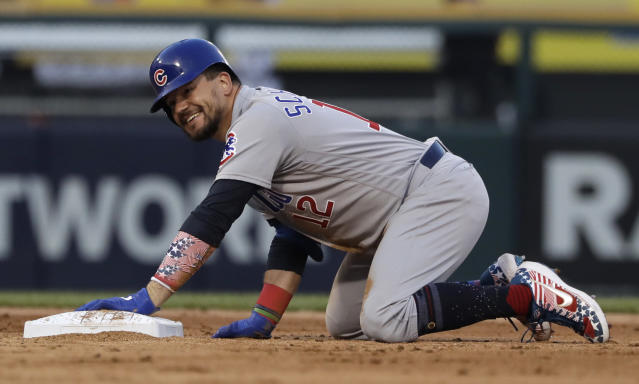 Chicago Cubs' Kyle Schwarber smiles at second base after hitting a two-run double against the Chicago White Sox during the fifth inning of a baseball game in Chicago, Saturday, July 6, 2019. (AP Photo/Nam Y. Huh)
