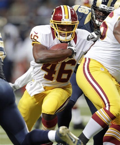 Washington Redskins running back Alfred Morris runs with the ball for a 3-yard gain during the first quarter of an NFL football game against the St. Louis Rams, Sunday, Sept. 16, 2012, in St. Louis. (AP Photo/Tom Gannam)