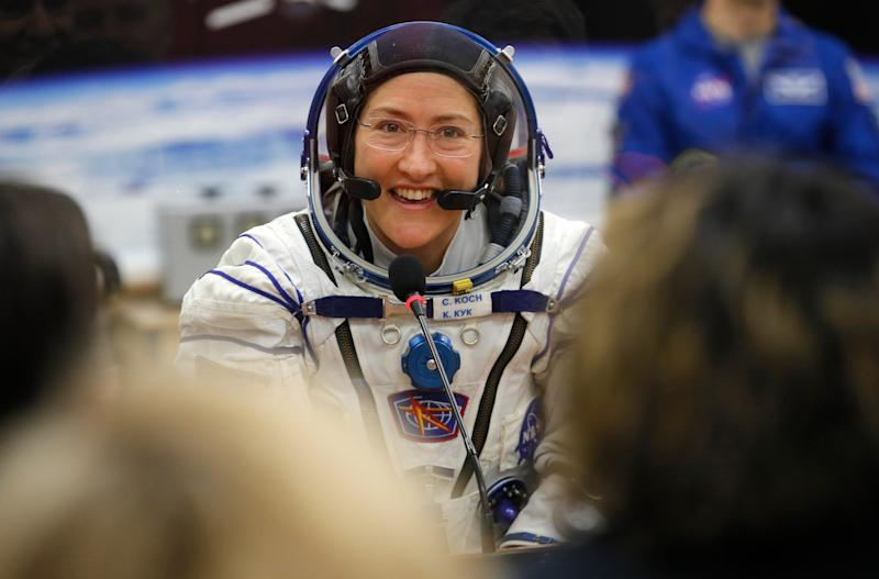 In this March 14, 2019 file photo, U.S. astronaut Christina Koch speaks with her relatives through a safety glass prior the launch.