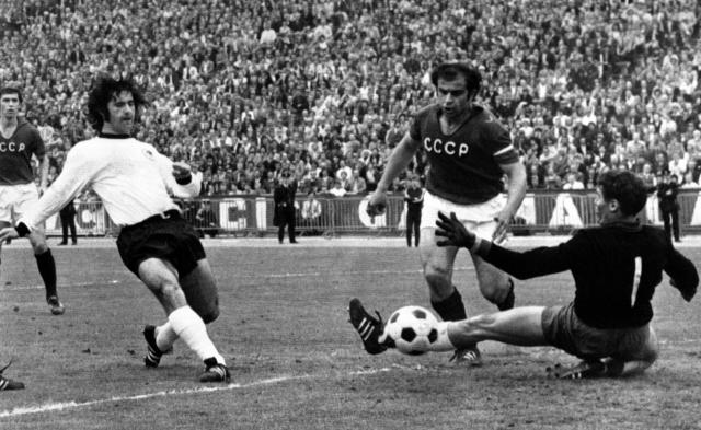 FILE - In this June 18, 1972 filer, the first goal for West Germany during match between West Germany and the Soviet Union in the Heysel Stadium, in Brussels, during the Final pf the UEFA European Cup of Nations. From left to right are: Gerd Muller of West Germany, Murtas Khurtsillava and goalkeeper Evgenij Rudakov of Soviet Union. On Wednesday, June 20, 2018 Cristiano Ronaldo scoring the only goal in Portugal's match against Morocco at the World Cup, Ronaldo became Europe's all-time leading goal-scorer with 85, overtaking Hungarian great Ferenc Puskas _ a star at Real Madrid, just like Ronaldo. (AP Photo, File)