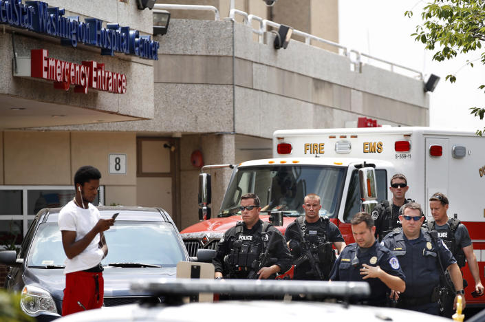 <p>Capitol Hill Police leave the emergency entrance at MedStar Washington Hospital Center in Washington, Wednesday, June 14, 2017, where House Majority Leader Steve Scalise of La. was taken after being shot in Alexandria, Va., during a Congressional baseball practice. (Photo: Jacquelyn Martin/AP) </p>