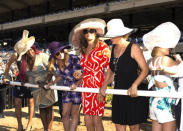 """<p>Following her amazing speech at the ESPY Awards, Jenner attended Opening Day of the Del Mar Racetrack in San Diego. To take in the races, she wore a flirty DVF silk wrap dress with a ruffle hem in a red twirl pattern (<a href=""""http://www.dvf.com/dvf-sylvia-silk-wrap-dress/D880301U15_WRAP.html?dwvar_D880301U15__WRAP_color=GTWRD&dwvar_D880301U15__WRAP_size=0#cgid=wrap-shop-fashion"""" rel=""""nofollow noopener"""" target=""""_blank"""" data-ylk=""""slk:you can have it too for $468"""" class=""""link rapid-noclick-resp"""">you can have it too for $468</a>!). She accessorized with an oversized hat and round sunglasses.</p>"""
