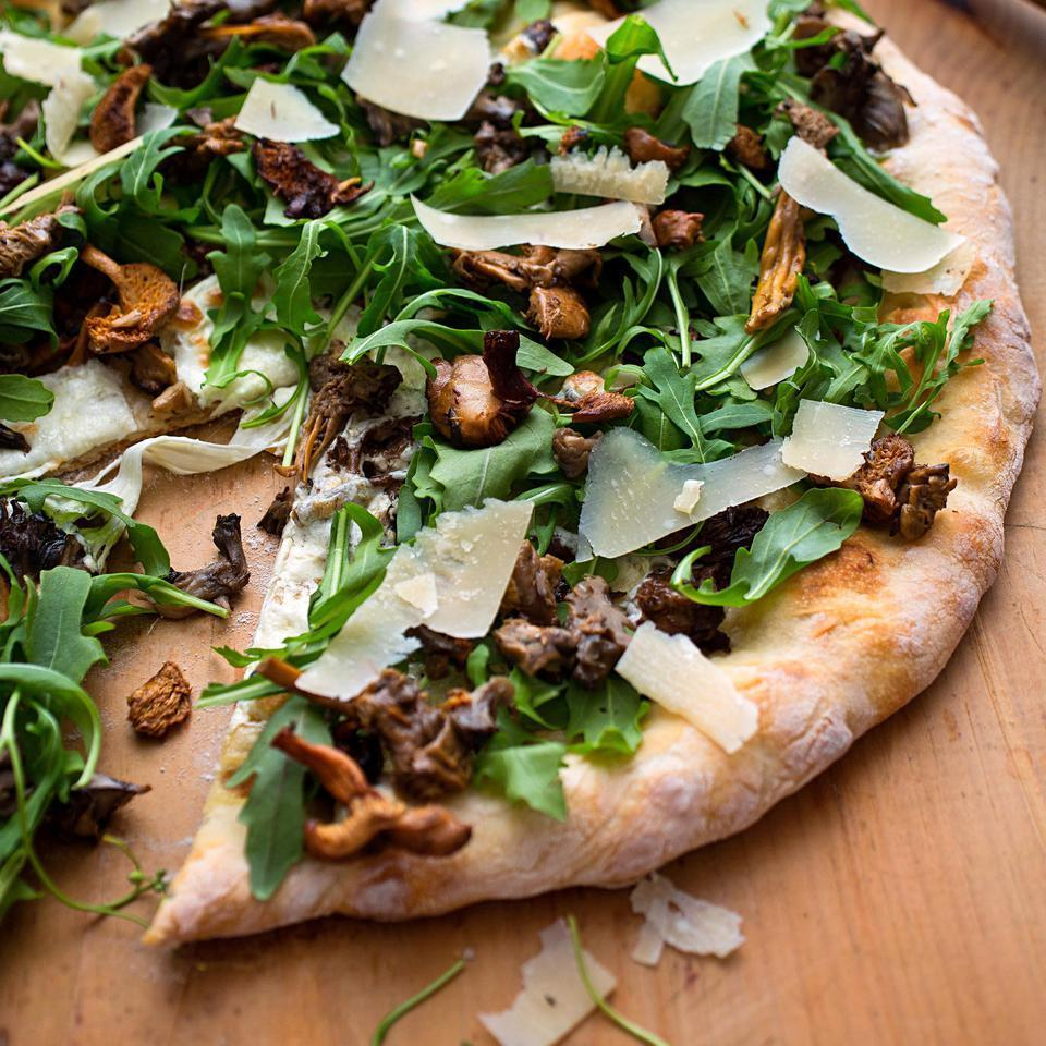 """<p>Make no mistake, this healthy pizza recipe is all about the mushrooms; lemon oil and arugula add just enough citrus and spiciness to accent without overwhelming. To that end, Sardinian or Tuscan Pecorino cheese (milder than Pecorino Romano) is called for, but other mellow grating cheeses, such as Parmigiano-Reggiano, will work. <a href=""""http://www.eatingwell.com/recipe/251178/wild-mushroom-pizza-with-arugula-pecorino/"""" rel=""""nofollow noopener"""" target=""""_blank"""" data-ylk=""""slk:View recipe"""" class=""""link rapid-noclick-resp""""> View recipe </a></p>"""