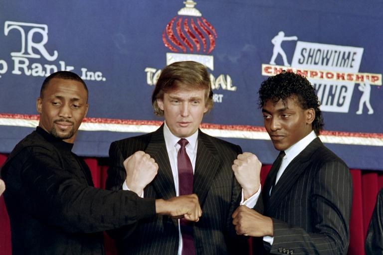 Donald Trump in 1990 with boxers Thomas 'The Hitman' Hearns and Michael 'The Silk' Olajide on the right