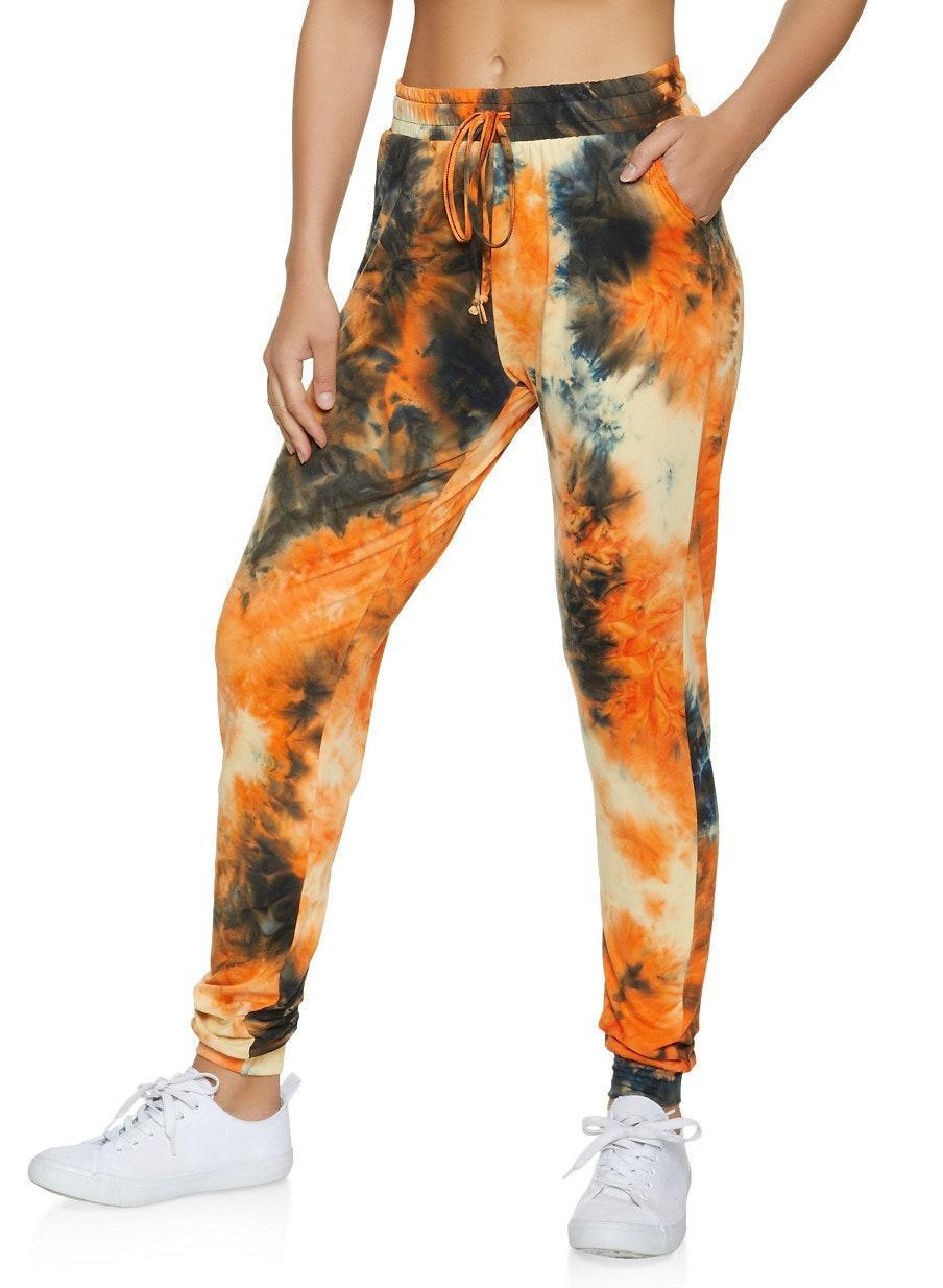 "$10, Rainbow. <a href=""https://www.rainbowshops.com/p/tie-dye-smocked-waist-joggers-1061074010571.html#!orange"" rel=""nofollow noopener"" target=""_blank"" data-ylk=""slk:Get it now!"" class=""link rapid-noclick-resp"">Get it now!</a>"