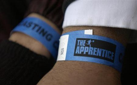 Potential contestants show arm bands while waiting to try out for new Apprentice shows.