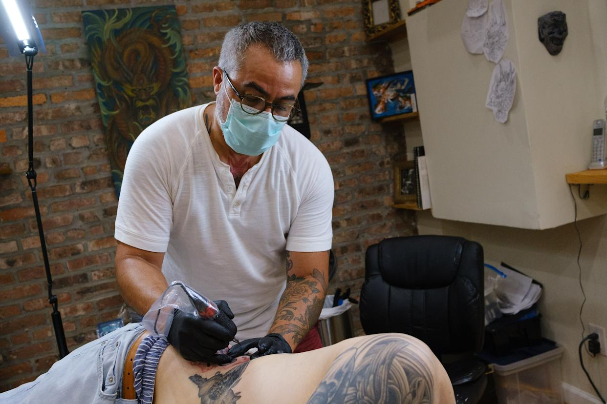 Tattoo artist Ray Jerez tattoos a client at Inborn Tattoo on 3rd Ave. in Brooklyn, New York on Monday, July 6, 2020.