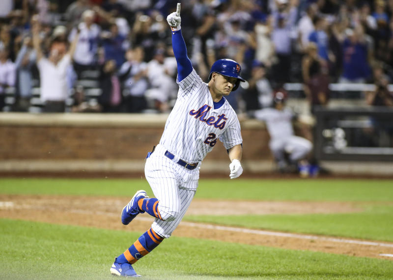 Aug 21, 2019; New York City, NY, USA; New York Mets left fielder J.D. Davis (28) hits a game winning RBI single defeat the Cleveland Indians in the tenth inning to at Citi Field. Mandatory Credit: Wendell Cruz-USA TODAY Sports