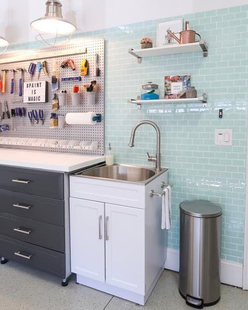 """<p>Sometimes you just need to start from scratch. This complete garage makeover includes not only a pegboard, but also loads of cabinet space underneath the workbench and utility sink. (And those turquoise peel-and-stick tiles are to die for!)</p><p><strong>Get the tutorial at <a href=""""https://porchdaydreamer.com/girl-meets-garage-makeover-reveal/"""" rel=""""nofollow noopener"""" target=""""_blank"""" data-ylk=""""slk:Porch Daydreamer"""" class=""""link rapid-noclick-resp"""">Porch Daydreamer</a>.</strong></p><p><a class=""""link rapid-noclick-resp"""" href=""""https://www.amazon.com/Transolid-TCA-2420-WS-Laundry-Cabinet-Faucet/dp/B07Z6KTN8P/ref=sr_1_16?tag=syn-yahoo-20&ascsubtag=%5Bartid%7C10050.g.36449426%5Bsrc%7Cyahoo-us"""" rel=""""nofollow noopener"""" target=""""_blank"""" data-ylk=""""slk:SHOP SINKS WITH CABINETS"""">SHOP SINKS WITH CABINETS</a></p>"""