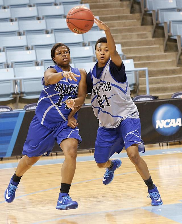 Hampton players Alyssa Bennett, right, and Blake Jenkines battle for the ball during practice at the NCAA women's college basketball tournament in Chapel Hill, N.C., March 22, 2014. Hampton plays Michigan State in a first-round game on Sunday. (AP Photo/Ellen Ozier)