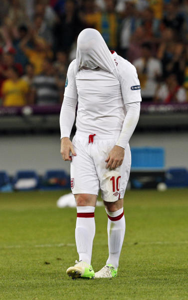 England's Wayne Rooney reacts after losing the penalty shootout of the Euro 2012 soccer championship quarterfinal match between England and Italy in Kiev, Ukraine, Monday, June 25, 2012. (AP Photo/Michael Sohn)