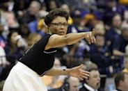 LSU basketball coach Nikki Caldwell signals to her team in the second half of an NCAA college basketball second-round tournament game against West Virginia Tuesday, March 25, 2014, in Baton Rouge, La. LSU won 76-67. (AP Photo/Rogelio V. Solis)