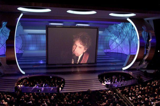 PHOTO: Bob Dylan is shown on a giant screen at the 73rd Annual Academy Awards at the Shrine Auditorium in Los Angeles, March 25, 2001. Dylan won the Oscar for Best Original Song for 'Things Have Changed' from the movie 'Wonder Boys.'  (Timothy A. Clary/AFP/Getty Images)