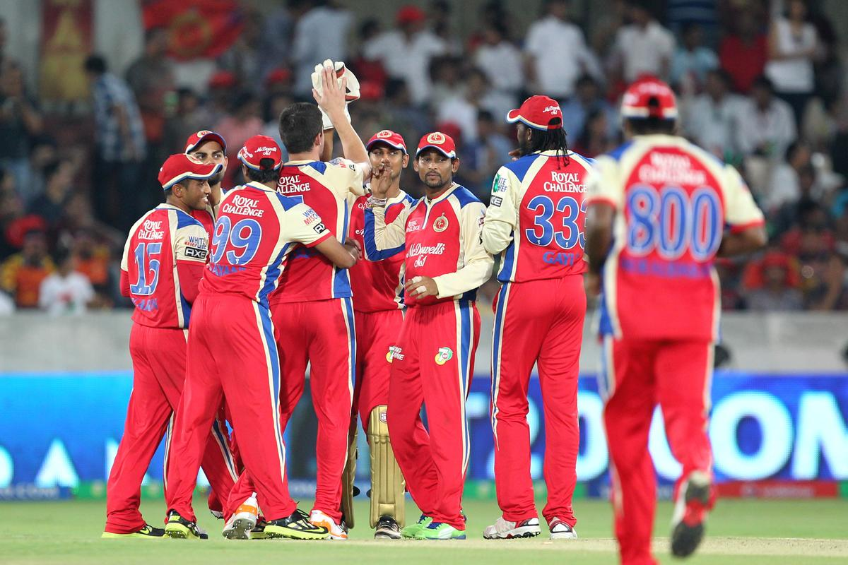 RCB's players celebrates wicket of Parthiv Patel during match 7 of the Pepsi Indian Premier League between The Sunrisers Hyderabad and Royal Challengers Bangalore held at the Rajiv Gandhi International Stadium, Hyderabad on the 7th April 2013Photo by Prashant Bhoot-IPL-SPORTZPICS Use of this image is subject to the terms and conditions as outlined by the BCCI. These terms can be found by following this link:https://ec.yimg.com/ec?url=http%3a%2f%2fwww.sportzpics.co.za%2fimage%2fI0000SoRagM2cIEc&t=1506176738&sig=QcwFaAQ8CyCvMUcWwU94JQ--~D