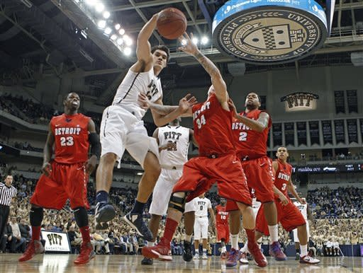 Pittsburgh's Steven Adams (13) goes for a rebound with Detroit's Nick Minnerath (34)in the first half of an NCAA college basketball game Saturday, Dec. 1, 2012, in Pittsburgh. (AP Photo/Keith Srakocic)
