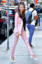 <p>Speaking of trouser suits, this Peter Dundas Resort double-breasted pink and black suit is a VIBE. I'm also obsessed with that sky-high ponytail.</p>