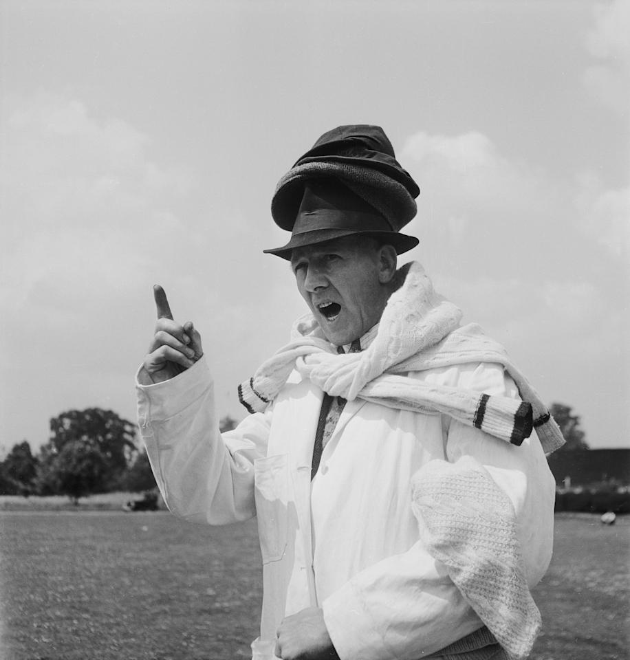9th June 1949:  Umpire Arthur Belson wears several hats and sweaters at once during a cricket match at Amersham Hill. Customarily, the umpire will hand the bowler his sweater once his stint is over.  (Photo by Chris Ware/Keystone Features/Getty Images)