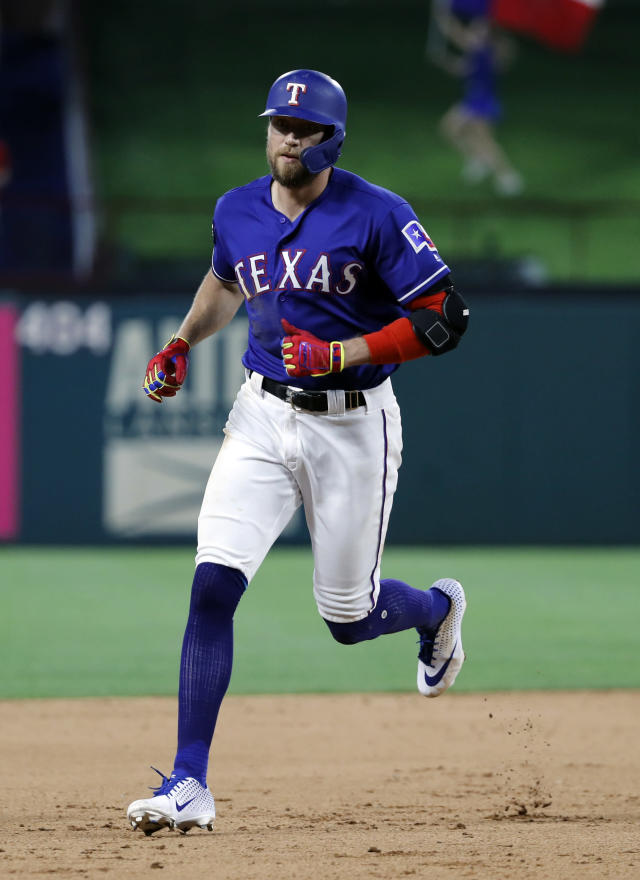 Texas Rangers' Hunter Pence rounds the bases after hitting a two-run home run off Seattle Mariners relief pitcher Ryan Garton in the seventh inning of a baseball game in Arlington, Texas, Monday, May 20, 2019. The shot also scored Nomar Mazara. (AP Photo/Tony Gutierrez)