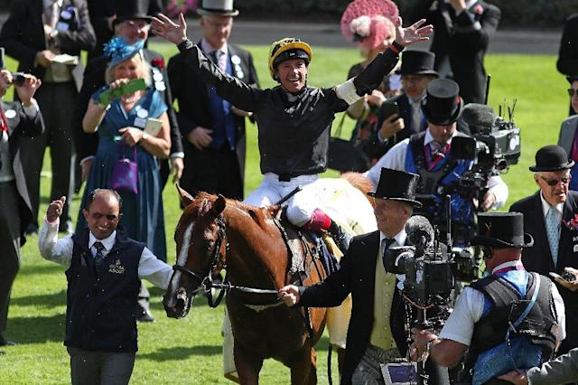 Superstar Frankie Dettori rode a sublime race on Stradivarius to win Royal Ascot's most historic race the Ascot Gold Cup for the sixth time and record his 60th winner at the meeting in a thrilling contest (AFP Photo/Daniel LEAL-OLIVAS)
