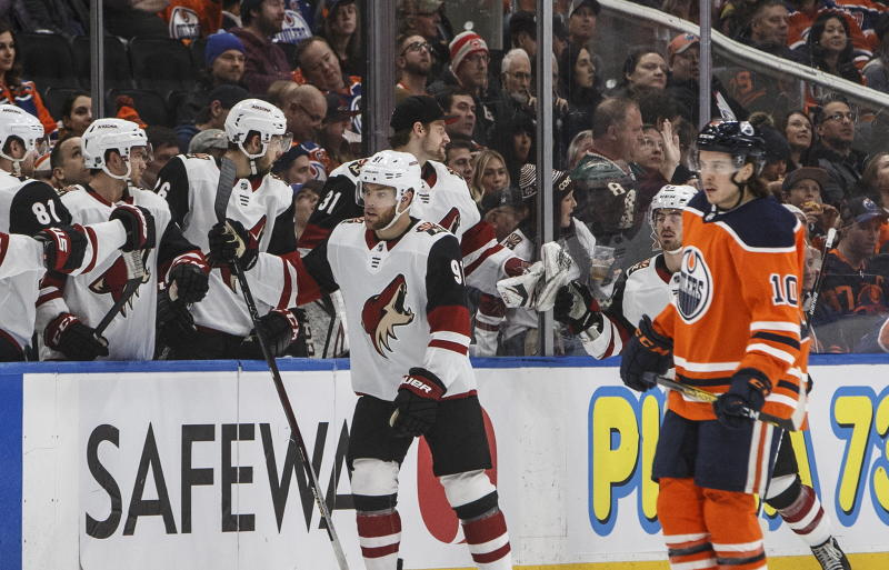 Arizona Coyotes' Taylor Hall (91) celebrates a goal as Edmonton Oilers' Joakim Nygard (10) skates past during second period NHL action in Edmonton, Alberta, on Saturday, Jan. 18, 2020. (Jason Franson/The Canadian Press via AP)