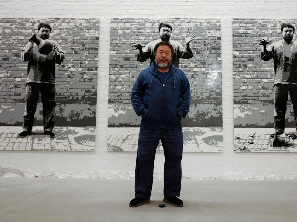Ai Weiwei in front of his work, Dropping a Han Dynasty Urn, 2016, at his studio in BerlinAFP via Getty
