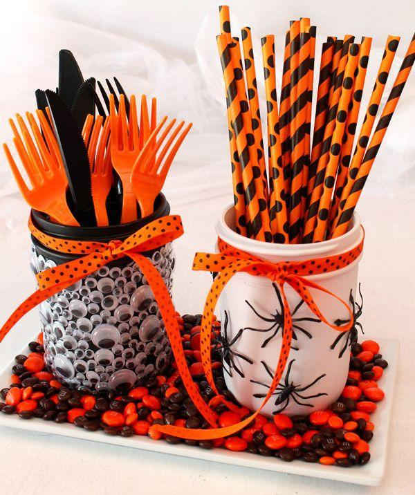 """<p>Use creepy-crawly spiders and googly eyes to decorate Mason jars and dress up festive cutlery. Tack on a candy-filled tray and you're Halloween party ready. </p><p><strong>Get the tutorial at <a href=""""https://www.merakilane.com/diy-mason-jar-halloween-decorations/"""" rel=""""nofollow noopener"""" target=""""_blank"""" data-ylk=""""slk:Meraki Lane"""" class=""""link rapid-noclick-resp"""">Meraki Lane</a>. </strong></p><p><strong><a class=""""link rapid-noclick-resp"""" href=""""https://www.amazon.com/Variety-approx-1120-Plastic-self-adhesive-Assorted/dp/B01KSRF3FQ/?tag=syn-yahoo-20&ascsubtag=%5Bartid%7C10050.g.3739%5Bsrc%7Cyahoo-us"""" rel=""""nofollow noopener"""" target=""""_blank"""" data-ylk=""""slk:SHOP GOOGLY EYES"""">SHOP GOOGLY EYES</a><br></strong></p>"""