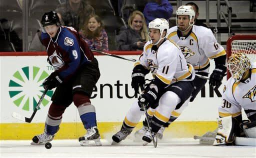 Colorado Avalanche center Matt Duchene (9) passes to Avalanche left wing Jamie McGinn, unseen, as Nashville Predators center David Legwand (11), defenseman Shea Weber (6) and goalie Chris Mason (30) defend during the second period of an NHL hockey game, Monday, Feb. 18, 2013, in Denver. McGinn scored on the play. Colorado won 6-5. (AP Photo/Joe Mahoney)