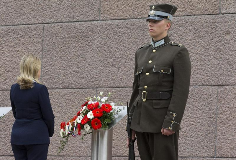U.S. Secretary of State Hillary Rodham Clinton pays her respects at the Freedom Monument, Thursday, June 28, 2012, in Riga, Latvia. (AP Photo/Haraz N. Ghanbari, Pool)