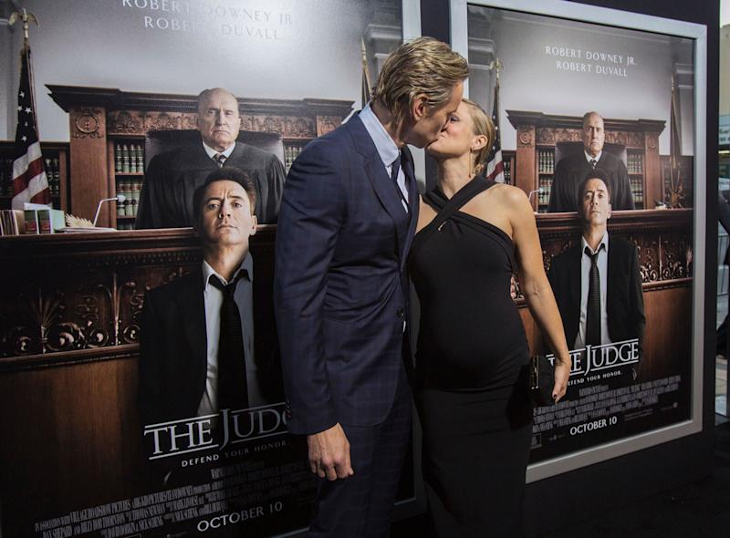 "Cast member Dax Shepard kisses his wife, Kristen Bell, at the premiere of ""The Judge"" at the Academy of Motion Picture Arts and Sciences in Beverly Hills, California, on Oct. 1, 2014."