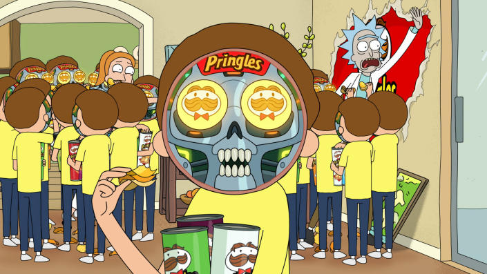 """This undated file image provided by Pringles shows a scene from the company's 2020 Super Bowl NFL football spot which partners with the show """"Rick and Morty."""" Pringle's enlisted Adult Swim's animated """"Rick and Morty"""" duo with a meta ad in which the characters realize they're stuck inside a Pringles commercial. (Pringles via AP, File)"""