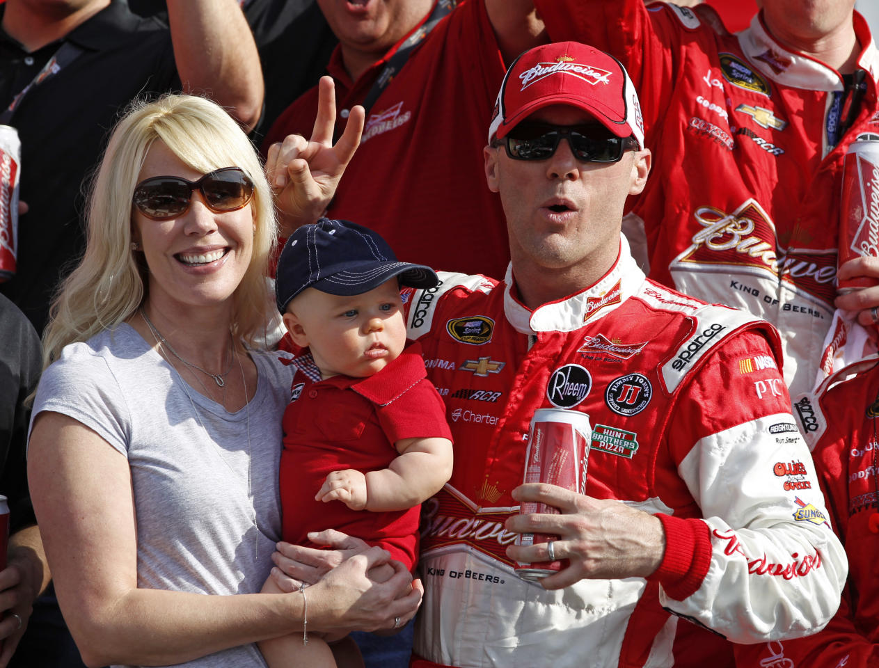 Kevin Harvick, right, celebrates with his wife, Delana, and daughter, Keelan, 7 months, in Victory Lane after winning the first of two 150-mile qualifying races for the NASCAR Daytona 500 auto race at Daytona International Speedway, Thursday, Feb. 21, 2013, in Daytona Beach, Fla. (AP Photo/Terry Renna)