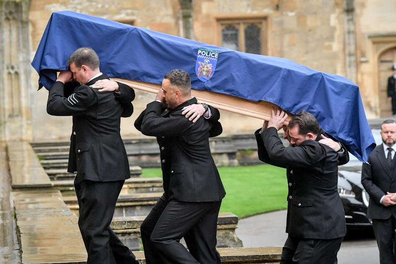 PC Harper's coffin is carried into Christ Church Cathedral in St Aldates by six police officers in full uniform. (PA)