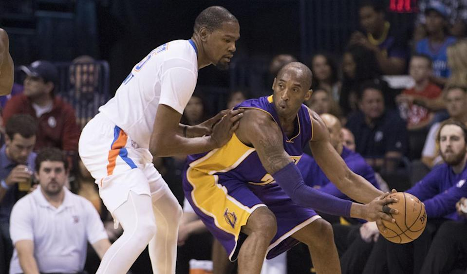 OKLAHOMA CITY, OK - APRIL 11: Kobe Bryant #24 of the Los Angeles Lakers tries to drive around Kevin Durant #35 of the Oklahoma City Thunder during the first quarter of a NBA game at the Chesapeake Energy Arena on April 22, 2016 in Oklahoma City, Oklahoma. NOTE TO USER: User expressly acknowledges and agrees that, by downloading and or using this photograph, User is consenting to the terms and conditions of the Getty Images License Agreement. J Pat Carter/Getty Images/AFPOKLAHOMA CITY, OK - APRIL 11: Kobe Bryant #24 of the Los Angeles Lakers tries to drive around Kevin Durant #35 of the Oklahoma City Thunder during the first quarter of a NBA game at the Chesapeake Energy Arena on April 22, 2016 in Oklahoma City, Oklahoma. NOTE TO USER: User expressly acknowledges and agrees that, by downloading and or using this photograph, User is consenting to the terms and conditions of the Getty Images License Agreement. J Pat Carter/Getty Images/AFP (AFP Photo/J Pat Carter)