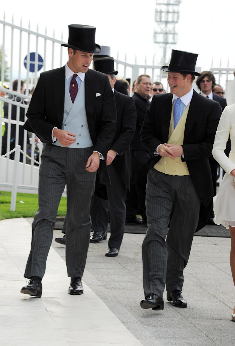 Prince William, Duke of Cambridge (L) and Prince Harry attend Investec Derby Day at the Investec Derby Festival at Epsom Downs Racecourse on June 4, 2011 in Epsom, England.