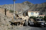 The evidence of Panjshir's resistance can be seen in the twisted and charred remains of Taliban armoured vehicles and pickups (AFP/Wakil Kohsar)