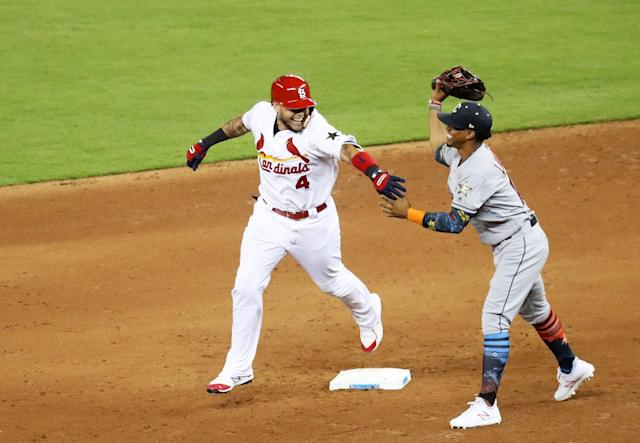 <p>Yadier Molina #4 of the St. Louis Cardinals and the National League jokes with Francisco Lindor #12 of the Cleveland Indians and the American League as he runs the bases after hitting a solo home run in the sixth inning during the 88th MLB All-Star Game at Marlins Park on July 11, 2017 in Miami, Florida. (Photo by Rob Carr/Getty Images) </p>