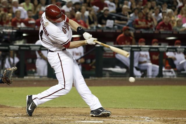 Arizona Diamondbacks' Paul Goldschmidt connects for a run-scoring double against the Houston Astros during the fourth inning of a baseball game on Monday, June 9, 2014, in Phoenix. (AP Photo/Ross D. Franklin)