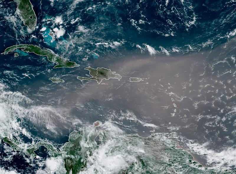 A satellite photo shows a cloud of dust coming from the Sahara desert arriving to the Caribbean Monday, June 22, 2020. The massive cloud of dust is blanketing the Caribbean as it heads to the U.S. with a size and concentration level that meteorologists say hasn't been seen in roughly half a century.