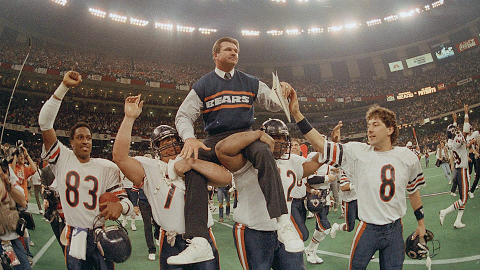 Mandatory Credit: Photo by Phil Sandlin/AP/Shutterstock (6577875a)MIKE DITKA Chicago Bears head coach Mike Ditka is carried off the field by Steve McMichael, left, and William Perry after the Bears win Super Bowl XX in New Orleans, La.