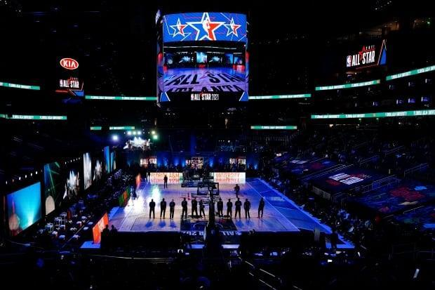 The NBA's all-star game, held Sunday in Atlanta without fans in the building, stands in stark contrast to a recent heavyweight bout in New Zealand which drew a sold-out, filled-to-capacity crowd less than one year since sports across the world shut down due to the pandemic. (Brynn Anderson/The Associated Press - image credit)
